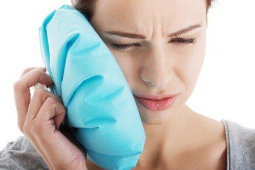 Làm gì để giảm đau và sưng tấy sau cấy răng implant