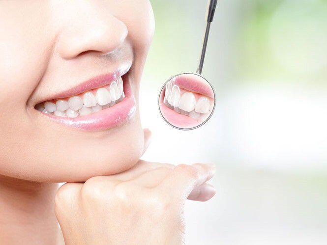 Tẩy trắng răng có làm răng ê buốt không